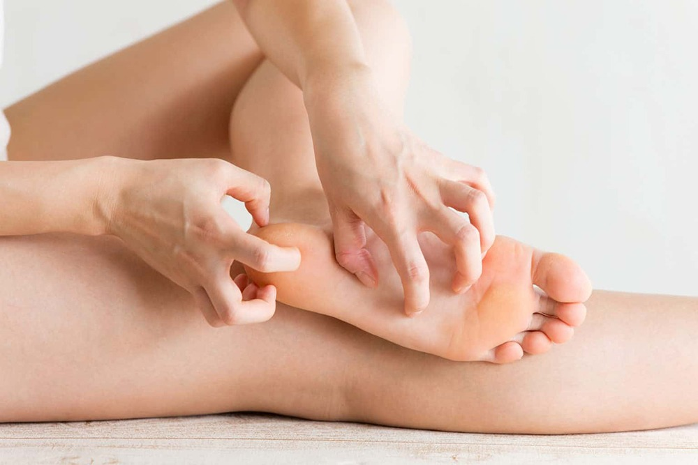 An itchy or burning sensation between your toes or the soles of your feet can be a symptom of athlete's foot.